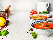 tomato soup with shrimps on rustic background