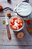 Strawberries with sugar in a glass jar