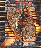 Two Galloway beef tomahawk steaks on a grill (top view)