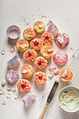 Cupcakes with pink and yellow icing