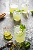 Freshly squeezed lemonade made with limes and brown sugar with a mint garnish