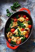 Chicken with tomato and kale in a casserole dish