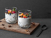 Yoghurt in a glass with gluten-free muesli and fresh fruits