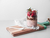 A vegan breakfast in a glass with yoghurt, muesli and strawberries