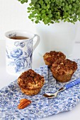Healthy gluten-free muffins with pecan streusel topping