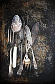 Antique cutlery on a rusty background