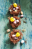 Easter nests with chocolate eggs and Easter chicks