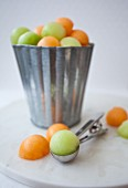 Melon balls in a metal bucket
