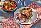 A rack of lamb with rosemary and grilled vegetables