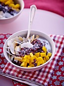 Black rice with coconut milk, mango and coconut chips