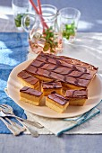 Shortbread with caramel and a chocolate glaze on a plate