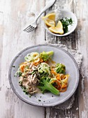 Veal strips in a creamy mushroom sauce with broccoli and carrot noodles