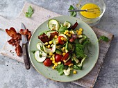 Zoodle (zucchini noodle) salad with sweetcorn, avocado and bacon