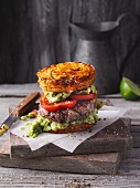 A sweet potato beefburger with avocado