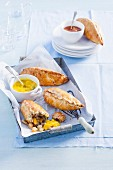 Cornish pasties with beef and vegetables, served with piccalilly chutney (England)