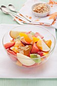 Mixed fruit salad with almond flakes