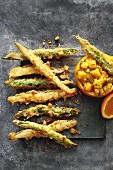 Asparagus tempura with orange and mango chutney