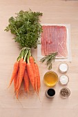 Ingredients for carrots wrapped in parma ham