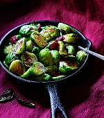 Fried brussels sprouts in a cast iron pan