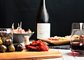 Various tapas and wine on a wooden table (Spain)