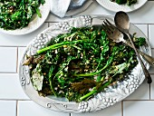 Fried broccolini with pine nuts on a vintage serving plate