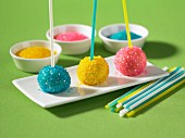 Truffles on sticks decorated with brightly coloured sugar