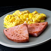 Fried breakfast ham with scrambled eggs
