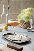 Pimm s with bourbon and honey syrup on styled table with flowers