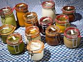 Various homemade stocks in glass jars