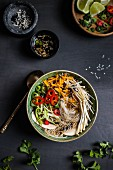 Asian noodle soup with chilli, carrots and mushrooms (top view)