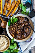 Braised ox tail with rice and pumpkin wedges (top view)