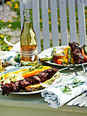 Venison skewers with grilled vegetables and herb butter