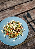 Asian mango and celery salad with bean sprouts and black sesame seeds
