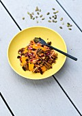 Pumpkin and red cabbage salad with orange and pecan nuts