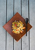 Oriental couscous salad with honeydew melon and cashew nuts