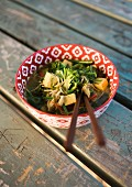 Asian soba noodle soup with tofu and vegetables