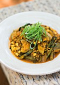 Unripe spelt grain and courgette stew with beans and sweetcorn