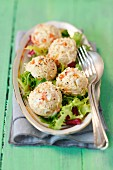 Poultry salad balls on a mixed leaf salad