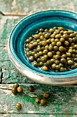 Pickled green peppercorns in a bowl
