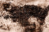 Black tea on a jute cloth (close up)