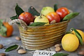 Fresh citrus fruits in a metal basket