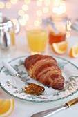 A croissant with orange marmalade