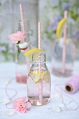 Pink lemonade in bottles