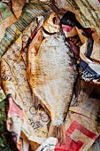 A dried fish in an old newspaper