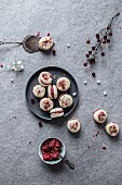 Raw coconut macarons with strawberry filling