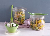 Buckwheat salad with avocado in glass jars