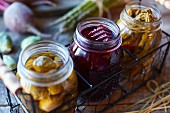 Pickled vegetables in jars (brussels sprouts, beetroot, asparagus)