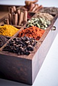 Various spices in a wooden box
