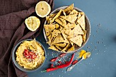 Spicy crackers with turmeric hummus (seen from above)