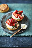 Scones with strawberries, vanilla whipped cream and wild sweet cicely